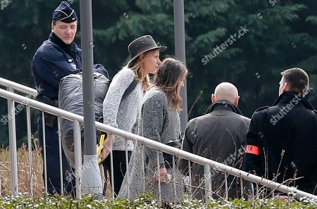 "Swiss snowboarder Anne-Flore Marxer, center wearing hat, arrives at the Roissy airport, outside Paris, France, after her return flight from Buenos Aires Argentina, . Marxer, a cast member of the European TV reality show ""Dropped,"" was in Villa Castelli, in Argentina's La Rioja province, when the two helicopters carrying fellow cast members collided in midair Monday, killing eight French nationals and the two Argentine pilots"