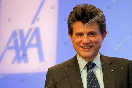 Henri De Castries, chairman and CEO of AXA, France's largest insurance company, poses for the media after the presentation of the company's full-year results in Paris, France, . Axa is Europe's second-largest insurance company by market capitalization behind Germany's Allianz. It operates in 56 countries with 157,000 employees