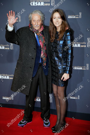 French actor Jean Rochefort waves as he arrives with his daughter Clemence, at the 40th French Cesar Awards Ceremony, in Paris, . This annual ceremony is presented by the French Academy of Cinema Arts and Techniques