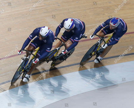 French team Gregory Bauge, left, Michael D'Almeida, center, and Kevin Sireau, right, compete during the final of the Men's Team Sprint race at the Track Cycling World Championships in Saint-Quentin-en-Yvelines, outside Paris, France, . France won gold, New Zealand won silver and Germany won bronze