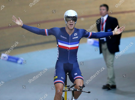 Stock Photo of Julien Morice of France, reacts after he won the third place during the final of the Men's Pursuit race at the Track Cycling World Championships in Saint-Quentin-en-Yvelines, outside Paris, France, . Stafan Keung of Switzerland won gold, Jack Bobridge of Australia won silver and Julien Morice of France won bronze