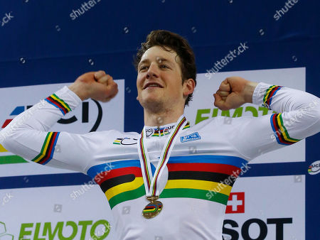 Stefan Kueng of Switzerland, poses with the gold medal during the medal ceremony the final of the Men's Pursuit race at the Track Cycling World Championships in Saint-Quentin-en-Yvelines, outside Paris, France, . Stafan Keung of Switzerland won gold, Jack Bobridge of Australia won silver and Julien Morice won bronze
