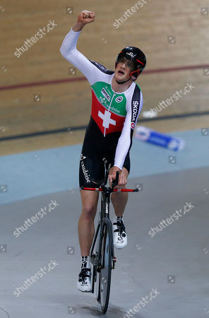 Stefan Kueng of Switzerland celebrates after winning the final of the Men's Pursuit race at the Track Cycling World Championships in Saint-Quentin-en-Yvelines, outside Paris, France, . Stafan Keung of Switzerland won gold, Jack Bobridge of Australia won silver and Julien Morice won bronze