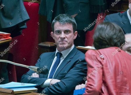 Stock Image of French prime minister Manuel Vals attends a session of the French National Assembly in Paris, . France's Parliament votes on a hotly debated and potentially landmark bill that loosens up some labor rules to boost hiring and notably allows stores to open Sundays and evenings for tourists. Leftists and labor unions say the bill is too pro-business, but the Socialist government says it's time to face modern economic realities