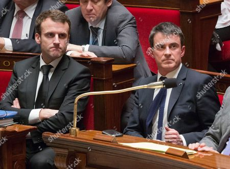 Stock Photo of French prime minister Manuel Vals, right, and French Economic minister Emmanuel Macron attend a session of the French National Assembly in Paris, . France's Parliament votes on a hotly debated and potentially landmark bill that loosens up some labor rules to boost hiring and notably allows stores to open Sundays and evenings for tourists. Leftists and labor unions say the bill is too pro-business, but the Socialist government says it's time to face modern economic realities