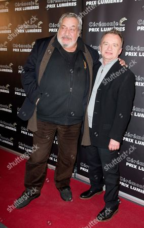 French actors Jean-Claude Dreyfus, left, and Dominique Pinon pose during the French Lumieres Award ceremony in Paris