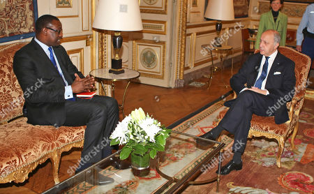 French foreign minister Laurent Fabius, right, speaks with his Malian counterpart Abdoulaye Diop, during their meeting at the foreign ministry in Paris, . Two children and a U.N. peacekeeper were killed in a rocket attack early Sunday on a U.N. base in Mali's northeastern city of Kidal