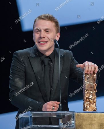 "French actor Kevin Azais reacts after winning the Best Male Newcomer award for ""Les Combattants"" (Love at First Fight) during the 40th Cesar Film Awards at Theatre du Chatelet in Paris, France,. This annual ceremony is presented by the French Academy of Cinema Arts and Techniques"