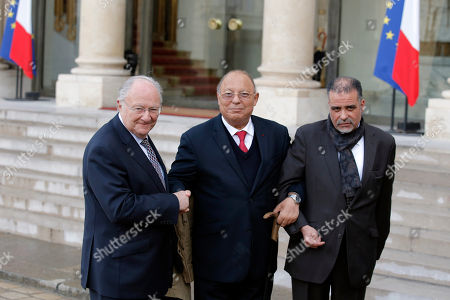 Roger Cukierman, head of the CRIF Jewish council, left, and Paris Mosque rector Dalil Boubakeur, with unidentified aide pose after a meeting at the Elysee Palace in Paris, France, . Cukierman and Boubakeur were summoned for a meeting at the Elysee to ease community tensions, following a statement made by Cukierman in which he claimed that the majority of antisemitic acts were caused by 'muslim youths