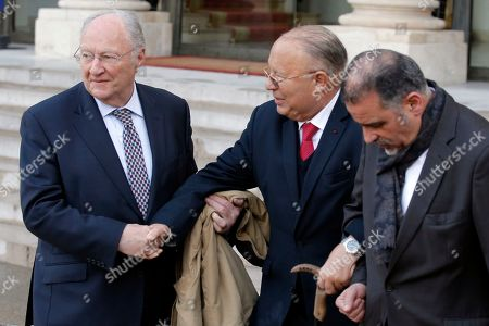 Roger Cukierman, head of the CRIF Jewish council, left, and Paris Mosque rector Dalil Boubakeur, center, with an unidentified aide shake hands after a meeting at the Elysee Palace in Paris, France, . Cukierman and Boubakeur were summoned for a meeting at the Elysee to ease community tensions, following a statement made by Cukierman in which he claimed that the majority of antisemitic acts were caused by 'muslim youths