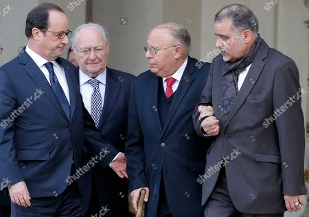 From left, Roger Cukierman, head of the CRIF Jewish council, French President Francois Hollande and Paris Mosque rector Dalil Boubakeur, along with an unidentified aide, walk out after a meeting at the Elysee Palace in Paris, France, . Cukierman and Boubakeur were summoned for a meeting at the Elysee to ease community tensions, following a statement made by Cukierman in which he claimed that the majority of antisemitic acts were caused by 'Muslim youths