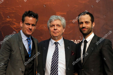 Stock Image of Stephane Lissner, Director of the National Opera of Paris, center, poses with Philippe Jordan, Musical Director of the Opera, left, and Benjamin Millepied, Dance Director of the Opera, during the presentation of the new 2015-2016 season of the Opera National of Paris at the Opera Bastille, in Paris, France, . The Opera National of Paris, mainly produces operas at its modern 2700-seat theatre Opera Bastille which opened in 1989, and ballets and some classical operas at the older 1970-seat Palais Garnier which opened in 1875