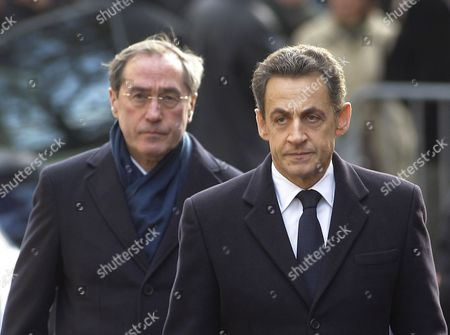 Nicolas Sarkozy, Claude Gueant Then French President Nicolas Sarkozy, right, and Interior Minister Claude Gueant, left, arrive for a ceremony commemorating the killing of a policewoman in Bourges, central France. Sarkozy's ex-chief of staff Gueant has been handed preliminary charges Sunday in an investigation into suspected illegal funding of Sarkozy's 2007 presidential campaign by late Libyan leader Moammar Gadhafi. Investigators suspect that a 500,000-euro ($545,000) sale of two 17th-century Flemish paintings by Gueant could be linked to illegal campaign funds