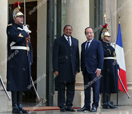 Tanzanian President Jakaya Mrisho Kikwete, left, poses for photographers with French President Francois Hollande prior to their meeting at the Elysee Palace in Paris