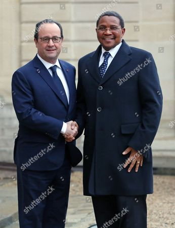 Tanzania's President Jakaya Mrisho Kikwete, right, is welcomed by French President Francois Hollande prior to their meeting at the Elysee Palace in Paris