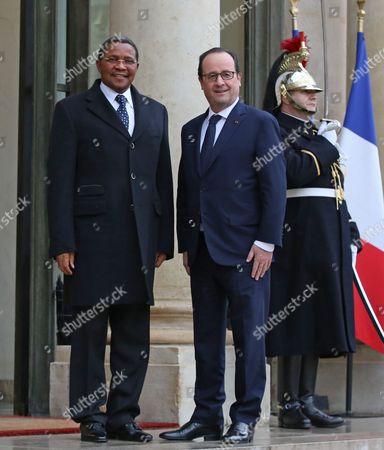 Tanzania President Jakaya Mrisho Kikwete, left, poses for photographers with French President Francois Hollande prior to their meeting at the Elysee Palace in Paris