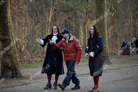 "Canadian film director Daniel Roby, center, prepares a scene with Scottish actor Stuart Bowman playing the role of Bontemps, at left, and British actor George Blagden playing the role of Louis XIV, right, during the filming of ""Versailles,"" in Sceaux, outside of Paris. Based on the larger-than-life King Louis XIV, the palace's first resident, an appropriately lavish $30-million budget make this 10-part series the most expensive show France has ever produced"