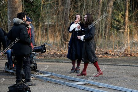 "Stock Image of Canadian film director Daniel Roby, second left, prepares a scene with Scottish actor Stuart Bowman playing the role of Bontemps, center left, and British actor George Blagden playing the role of Louis XIV, right, during the filming of ""Versailles,"" in Sceaux, outside of Paris. Based on the larger-than-life King Louis XIV, the palace's first resident, an appropriately lavish $30-million budget make this 10-part series the most expensive show France has ever produced"
