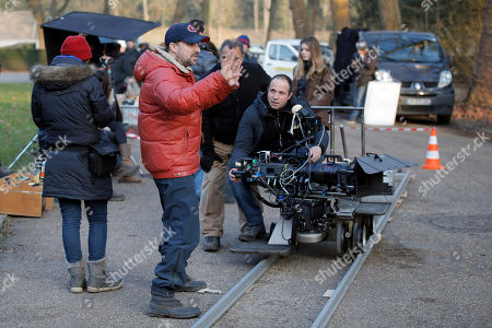 """Stock Photo of Canadian film director Daniel Roby, center, directs actors during the filming of """"Versailles,"""" in Sceaux, outside of Paris. Based on the larger-than-life King Louis XIV, the palace's first resident, an appropriately lavish $30-million budget make this 10-part series the most expensive show France has ever produced"""