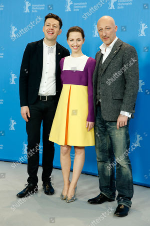 From left, Christian Friedel, Katharina Schuettler and Oliver Hirschbiegel pose for photographers at the photo call for the film 13 Minutes (Elser) at the 2015 Berlinale Film Festival in Berlin
