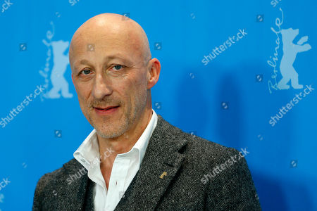 Director Oliver Hirschbiegel poses for photographers at the photo call for the film 13 Minutes (Elser) at the 2015 Berlinale Film Festival in Berlin