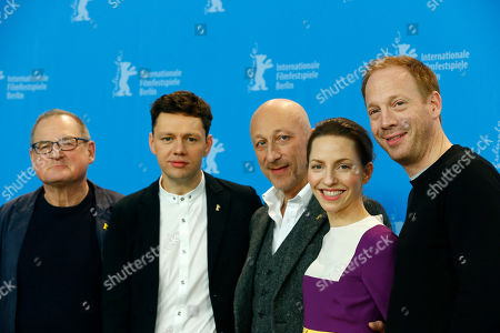 From left, Burghart Klaussner, Christian Friedel, Katharina Schuettler, Oliver Hirschbiegel and Johann von Buelow pose for photographers at the photo call for the film 13 Minutes (Elser) at the 2015 Berlinale Film Festival in Berlin