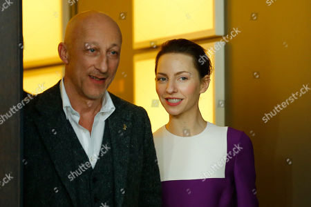Director Oliver Hirschbiegel and actress Katharina Schuettler arrive for the photo call for the film 13 Minutes (Elser) at the 2015 Berlinale Film Festival in Berlin