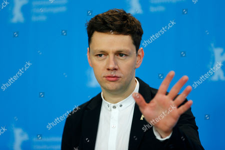 Actor Christian Friedel poses for photographers at the photo call for the film 13 Minutes (Elser) at the 2015 Berlinale Film Festival in Berlin