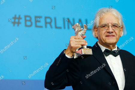 Patricio Guzman holds his Silver Bear for Best Script for El Boton de Nacar during press conference after the award ceremony at the 2015 Berlinale Film Festival in Berlin, Germany