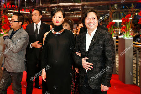 Stock Picture of Actress Do Thi Hai Yen and Calvin Tai Lam arrive on the red carpet for the award ceremony at the 2015 Berlinale Film Festival in Berlin, Germany