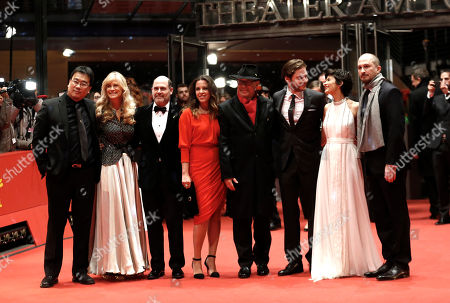 From left, Bong Joon-ho, Martha De Laurentiis, Matthew Weiner, Claudia Llosa, Dieter Kosslick, Daniel Bruehl, Audrey Tautou and Darren Aronofsky pose for photographers on the red carpet for the award ceremony at the 2015 Berlinale Film Festival in Berlin, Germany
