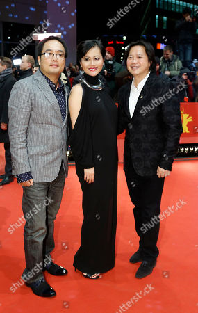 Director Phan Dang Di, actress Do Thi Hai Yen and Calvin Tai Lam pose for photographers on the red carpet for the award ceremony at the 2015 Berlinale Film Festival in Berlin, Germany
