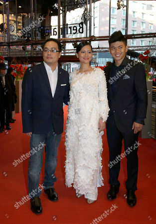 Phan Dang Di, Do Thi Hai Yen, Le Cong Hoang From left, Vietnamese director Phan Dang Di, actress Do Thi Hai Yen and actor Le Cong Hoang pose for photographers on the red carpet for the film Big Father, Small Father and Other Stories (Cha va Con va) at the 2015 Berlinale Film Festival in Berlin