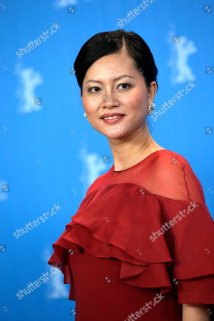 Actress Do Thi Hai Yen poses for photographers at the photo call for the film Big Father, Small Father and Other Stories (Cha va Con va) at the 2015 Berlinale Film Festival in Berlin
