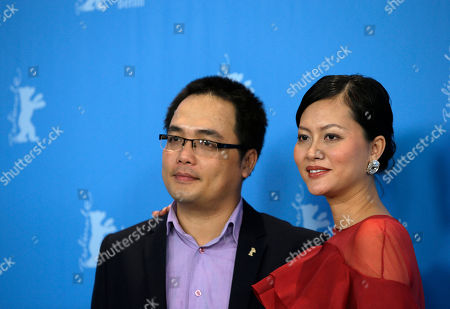 From left, Vietnamese director Phan Dang Di and actress Do Thi Hai Yen pose for photographers at the photo call for the film Big Father, Small Father and Other Stories (Cha va Con va) at the 2015 Berlinale Film Festival in Berlin