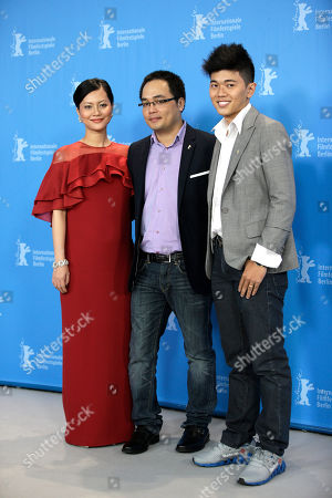 From left, Vietnamese director Phan Dang Di, actor Le Cong Hoang and actress Do Thi Hai Yen pose for photographers at the photo call for the film Big Father, Small Father and Other Stories (Cha va Con va) at the 2015 Berlinale Film Festival in Berlin