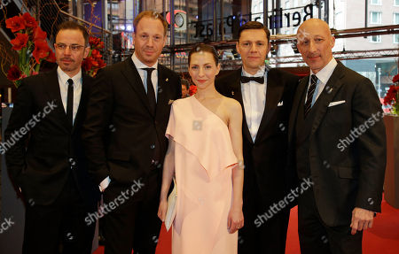 Director Oliver Hirschbiegel, right, poses with, from right, actor Christian Friedel, actress Katharina Schuettler and actor Johann von Buelow on the red carpet for Elser / 13 Minutes at the 2015 Berlinale Film Festival in Berlin