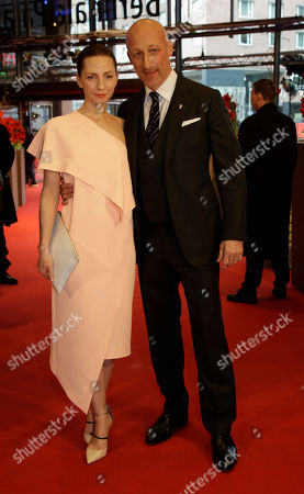Director Oliver Hirschbiegel, right, poses with actress Katharina Schuettler on the red carpet for Elser / 13 Minutes at the 2015 Berlinale Film Festival in Berlin
