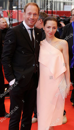 Actor Johann von Buelow, left, poses with actress Katharina Schuettler on the red carpet for Elser / 13 Minutes at the 2015 Berlinale Film Festival in Berlin
