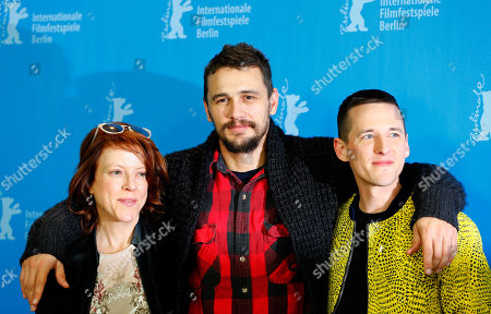 Actor James Franco is flanked by director Justin Kelly, right, and producer Lauren Selig during the photo call for the movie 'I am Michael' at the 2015 Berlinale Film Festival in Berlin