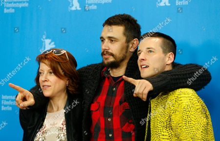 Stock Image of Actor James Franco is flanked by director Justin Kelly, right, and producer Lauren Selig during the photo call for the movie 'I am Michael' at the 2015 Berlinale Film Festival in Berlin