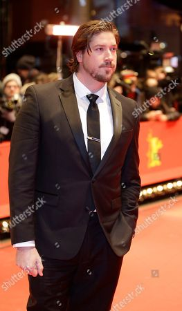 Producer Tanner Beard arrives on the red carpet for the film Knight of Cups at the 2015 Berlinale Film Festival in Berlin, Germany