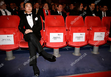 "Shota Sometani, husband of Japanese actress Rinko Kikuchi, watches the ceremony prior to the opening film ""Nobody Wants The Night"" at the 2015 Berlinale Film Festival in Berlin"