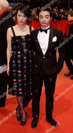 "Japanese actress Rinko Kikuchi, left, and her husband Shota Sometani arrive on the red carpet for the opening film ""Nobody Wants The Night"" at the 2015 Berlinale Film Festival in Berlin"