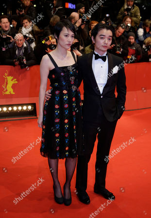 "Stock Image of Japanese actress Rinko Kikuchi, left, and her husband Shota Sometani arrive on the red carpet for the opening film ""Nobody Wants The Night"" at the 2015 Berlinale Film Festival in Berlin"