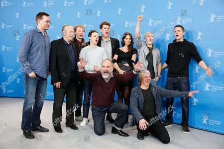 From left, Clemens Meyer, Wolfgang Kohlhaase, Ruby O. Fee, Marcel Heuperman, Merlin Rose, Joel Basman, Marcel Heuperman, Clemens Meyer, Ruby O. Fee, Julius Nitschkoff, Frederic Haselon, Front, Peter Rommel and Andreas Dresen poses at the photo call for the film As We Were Dreaming at the 2015 Berlinale Film Festival in Berlin