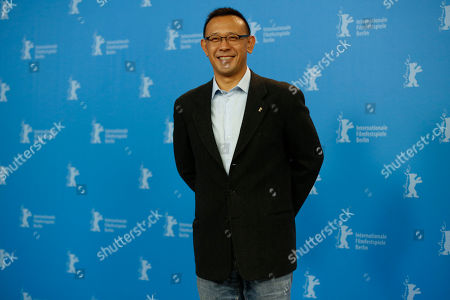 Director Jiang Wen poses for photographers at the photo call for the film Gone With The Bullets ( Yi Bu Zhi Yao) at the 2015 Berlinale Film Festival in Berlin