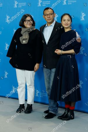 Actress Hung Huang, left, director Jiang Wen, center, and actress Zhou Yun pose for photographers at the photo call for the film Gone With The Bullets ( Yi Bu Zhi Yao) at the 2015 Berlinale Film Festival in Berlin