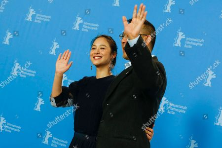 Actress Zhou Yun and director Jiang Wen, pose for photographers at the photo call for the film Gone With The Bullets ( Yi Bu Zhi Yao) at the 2015 Berlinale Film Festival in Berlin