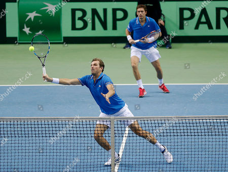 Julien Benneteau, left, and Nicolas Mahut play against Germany's Benjamin Becker and Andre Begemann in the doubles match during a first round tennis Davis Cup match between Germany and France in Frankfurt, Germany, . France won and has now an unassailable 3-0 lead and advances to the next round